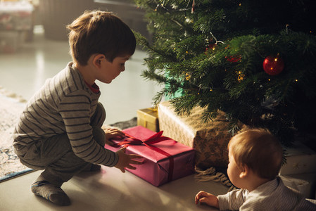 Boys picking up their christmas gifts