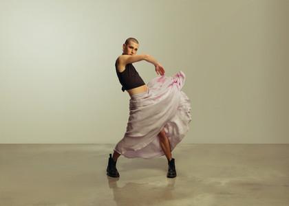 Gay man dancing wearing women clothing