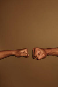 Two hands coming together for a fist bump