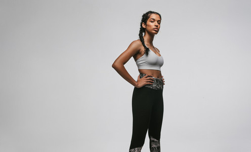Fit woman standing against white background