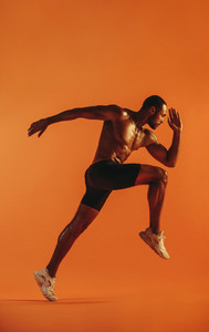 Side view of male athlete running