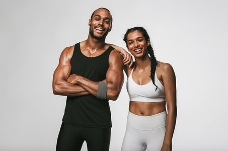 Portrait of smiling fitness couple