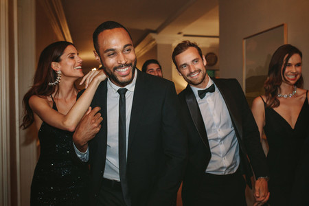 Friends having fun together at a gala event