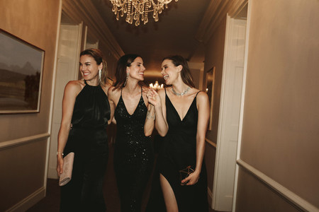 High society women at gala night party