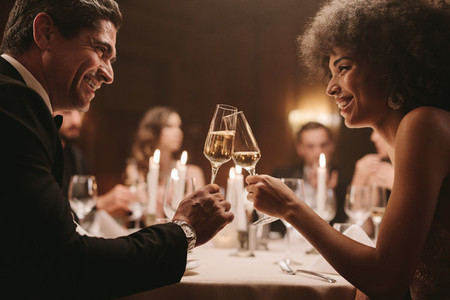 Couple at party enjoying drink
