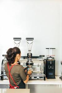 Back view of a female barista