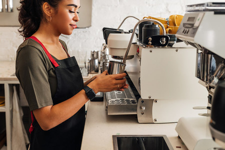 Side view of a female barista