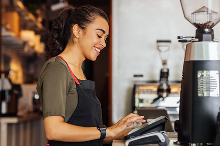 Side view of smiling waitress