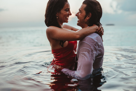 Romantic couple on a vacation in an infinity pool