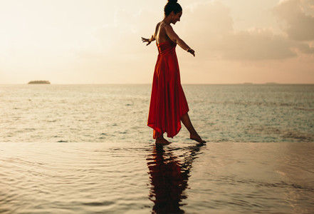 Tourist woman enjoying vacation at the sea