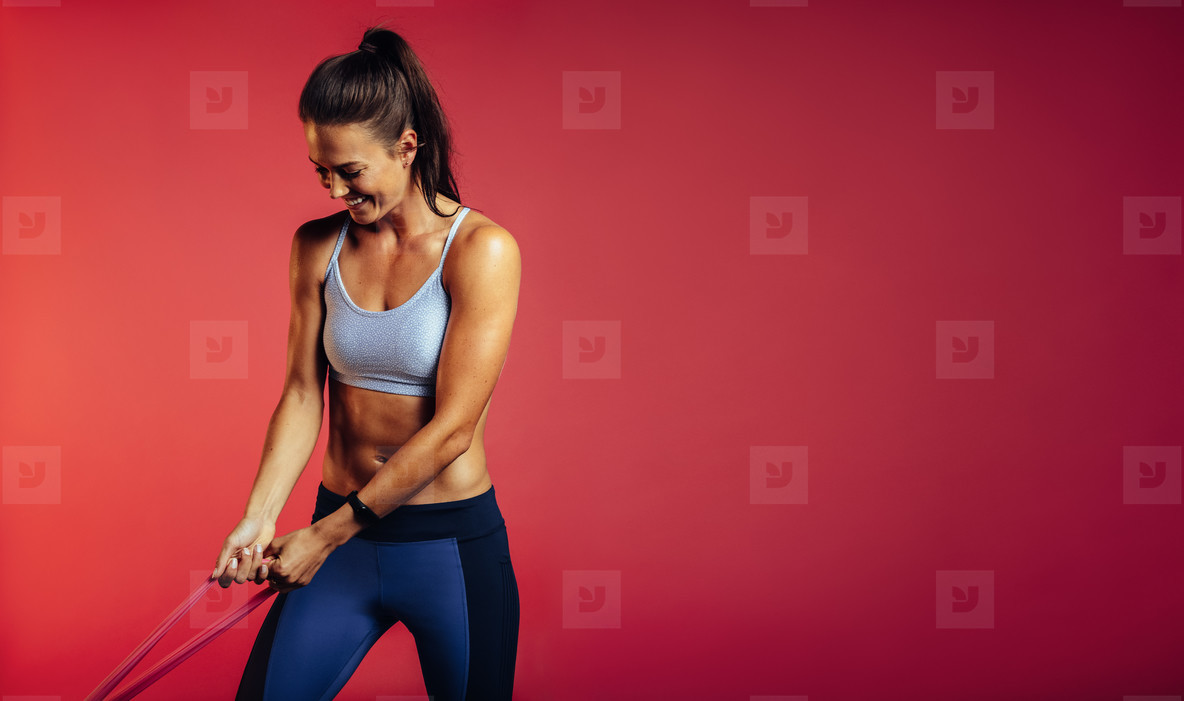 Woman working out with stretch bands