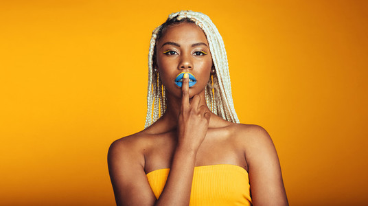 African american woman on yellow background