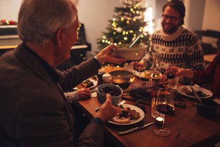 Family celebrating Christmas eve with delicious food