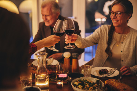 Family enjoying Christmas dinner at home