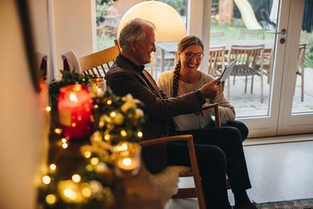 Senior couple video calling family on Christmas