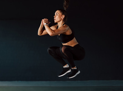 Sports woman jumping in gym