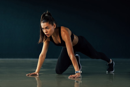 Young fit woman stretching legs