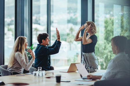 Business people celebrating success in conference room