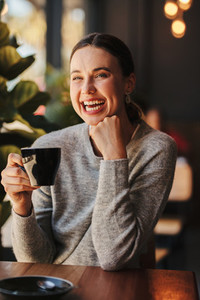 Woman enjoying at a coffee shop