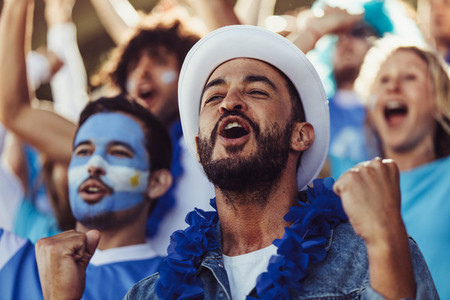 Argentina football fans at stadium cheering a goal