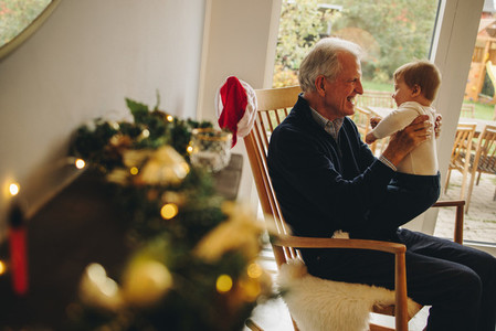 Elderly man with his grandson on a christmas eve
