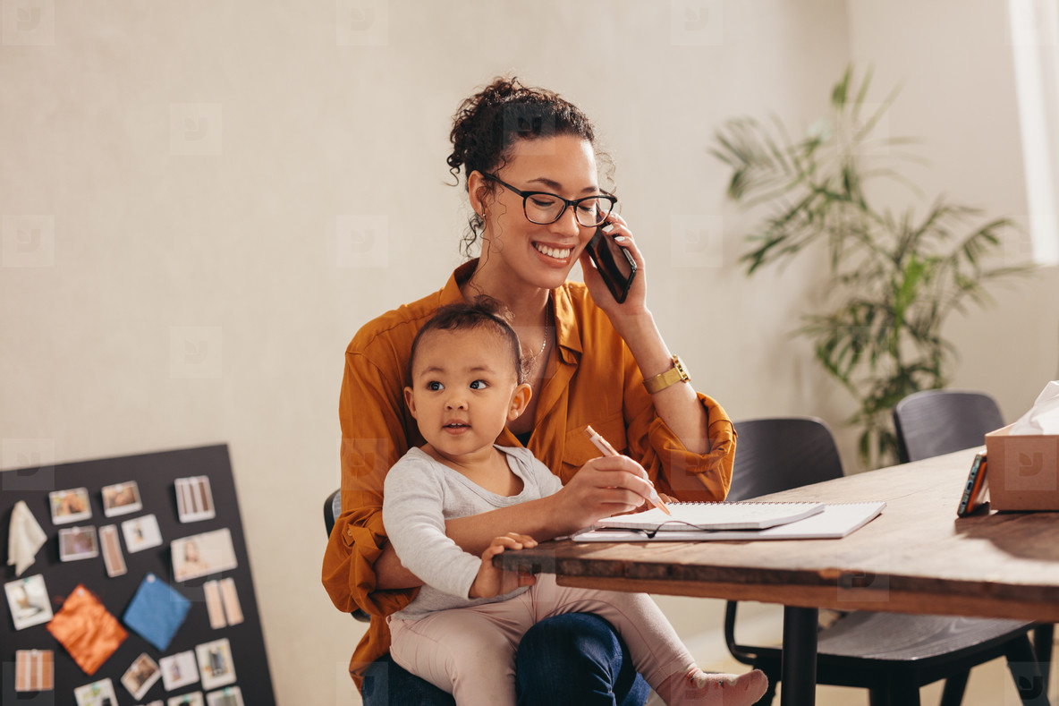 Working mom with child talking on phone