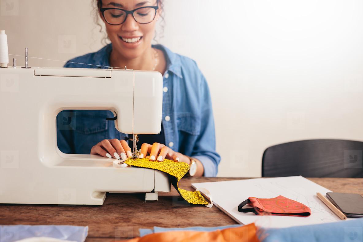 Woman sewing homemade masks at home