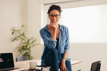 Woman sitting at home office