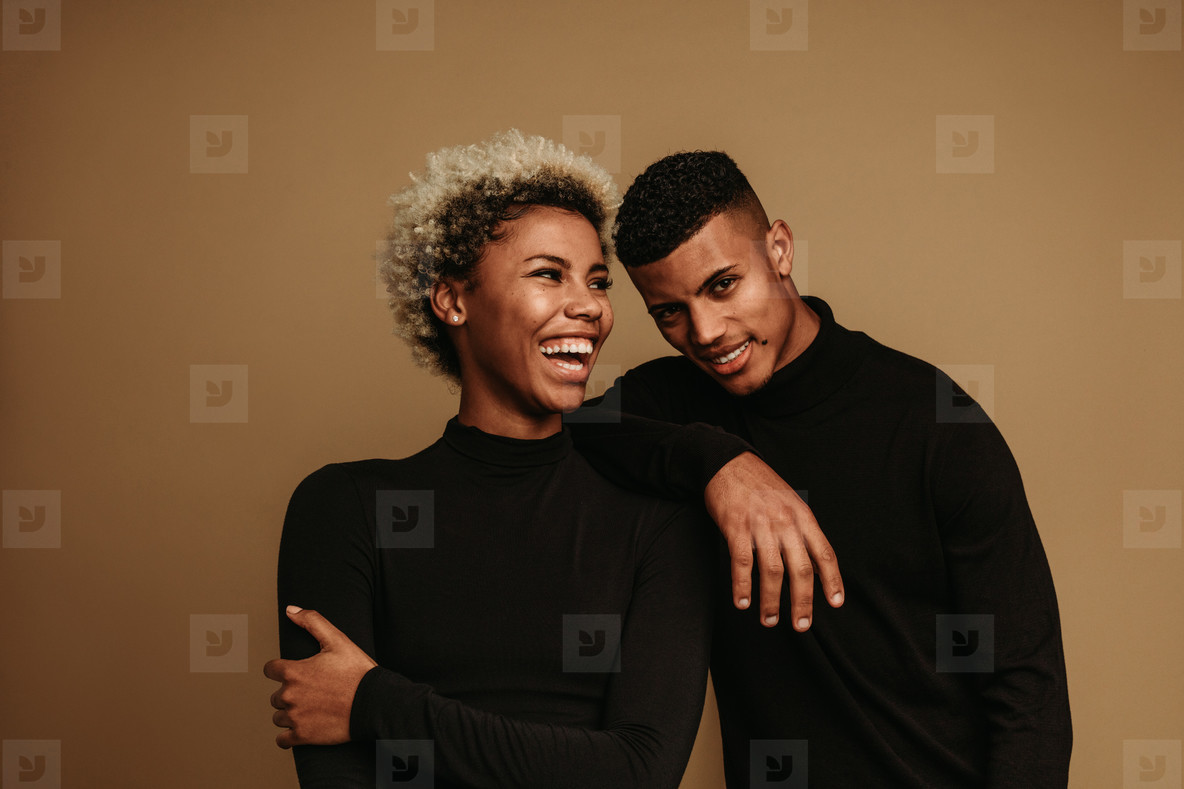 Cheerful african american couple standing together