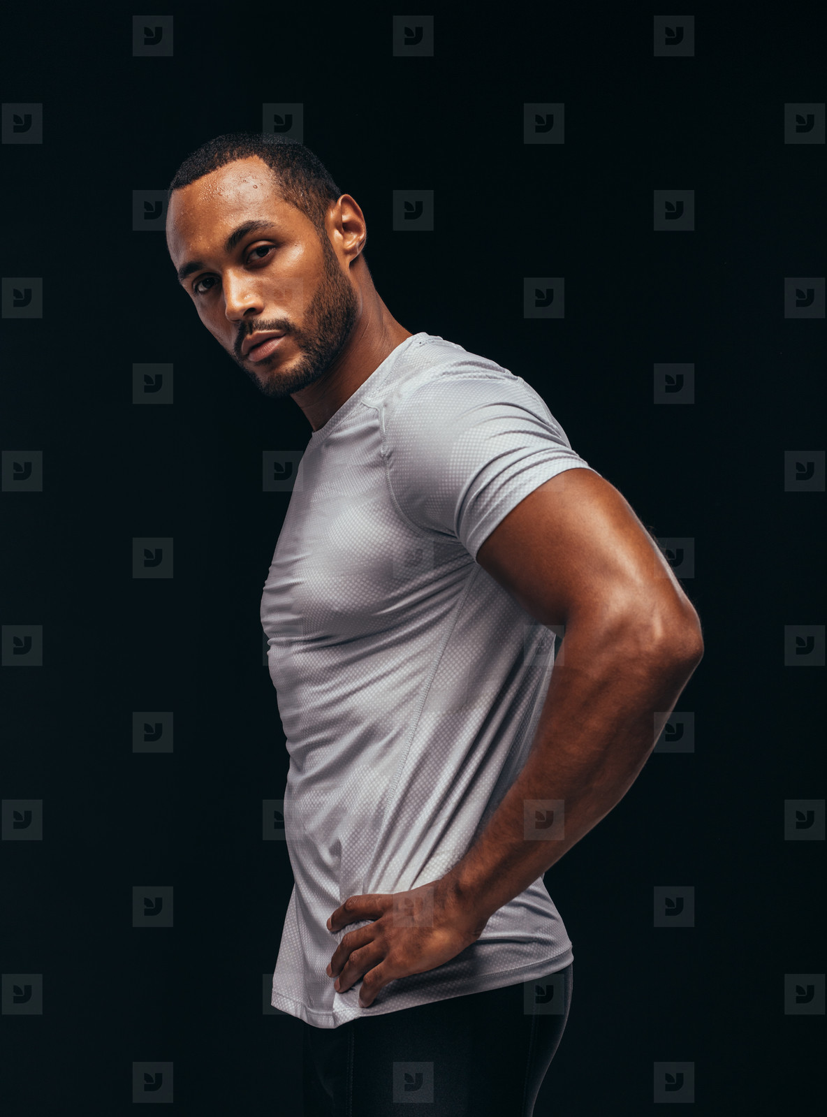 Monochrome fitness portrait of muscular athlete