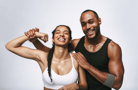 Fitness couple relaxing after workout
