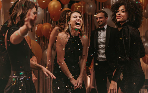 Group of socialites enjoying dancing at new years party
