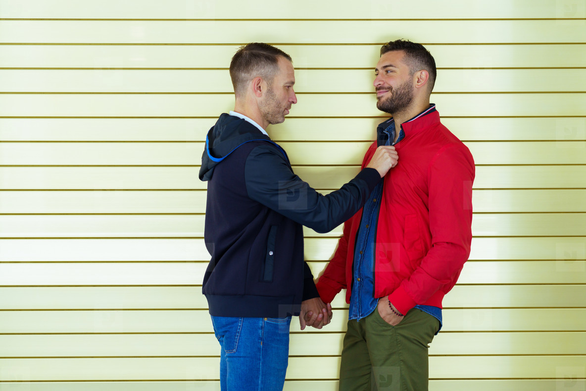 Gay couple in a romantic moment on the street