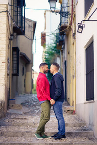 Gay couple in a romantic moment in the street