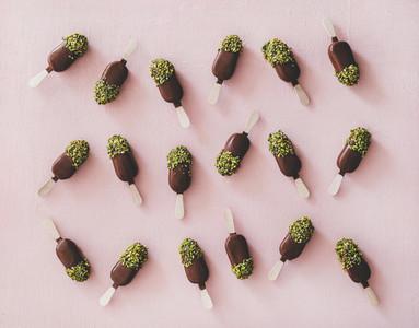Chocolate glazed ice cream pops with pistachio icing  top view