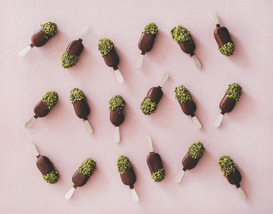 Chocolate glazed ice cream pops with pistachio icing  top view