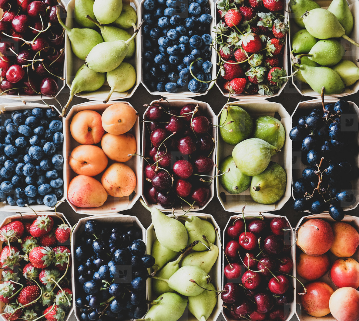 Fresh summer fruits and berries in eco friendly wooden boxes   close up