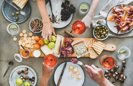 Mid summer seasonal picnic with rose wine  cheese  charcuterie and appetizers