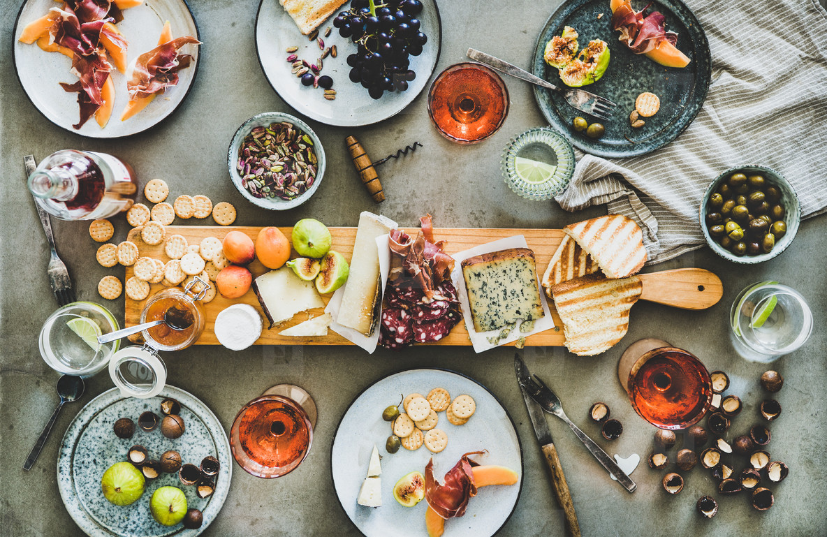Seasonal picnic with rose wine  cheese  charcuterie  nuts and fruits