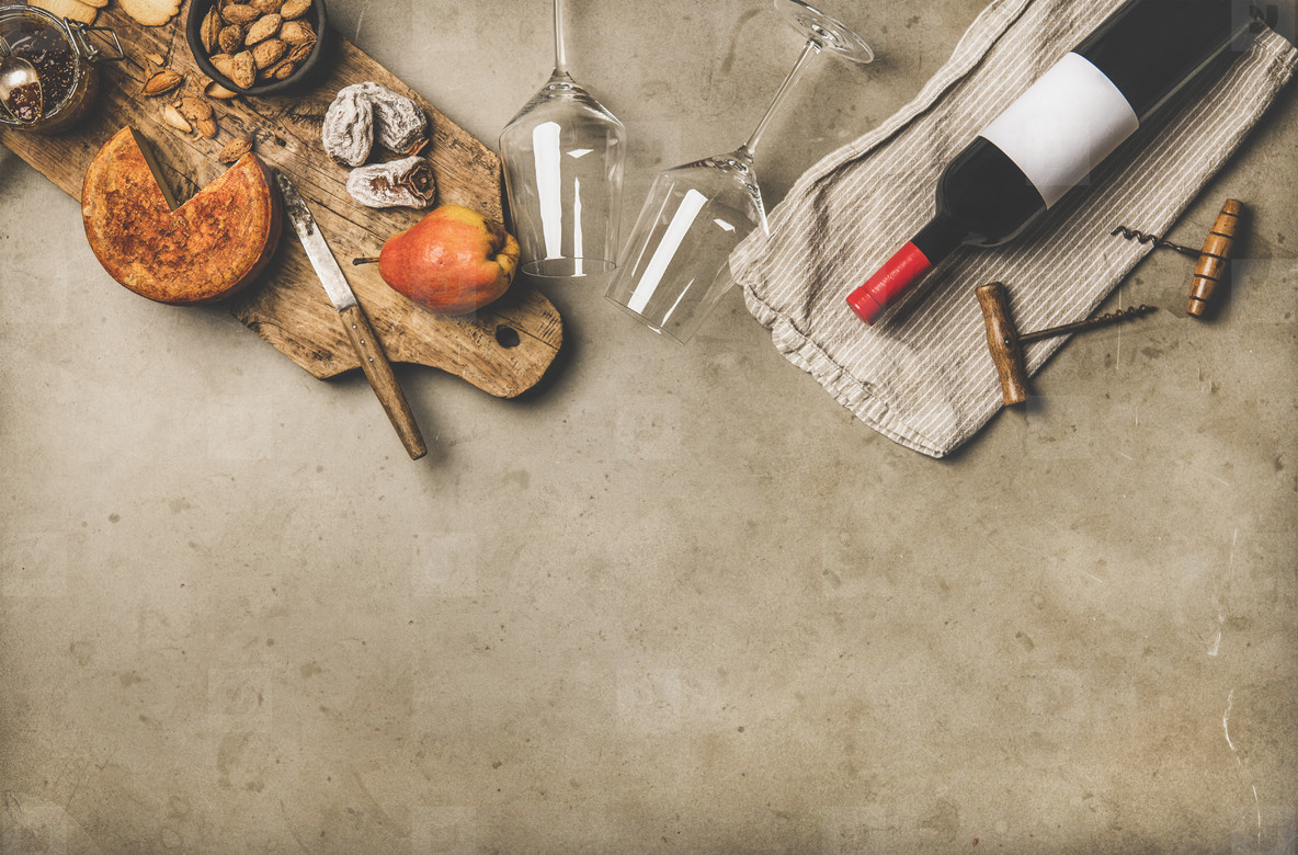 Wine and snack set with over concrete background  copy space
