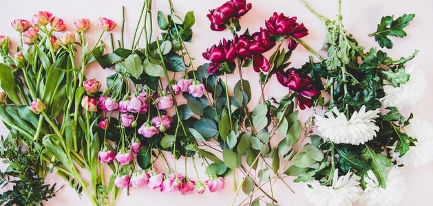 Flat lay of purple peonies pink roses tulips white chrisanthemums