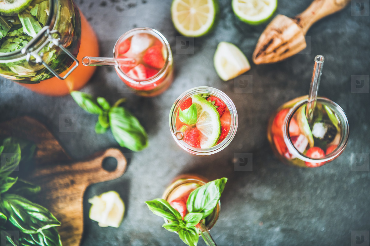 Fresh homemade lemonade with strawberry and basil leaves  top view