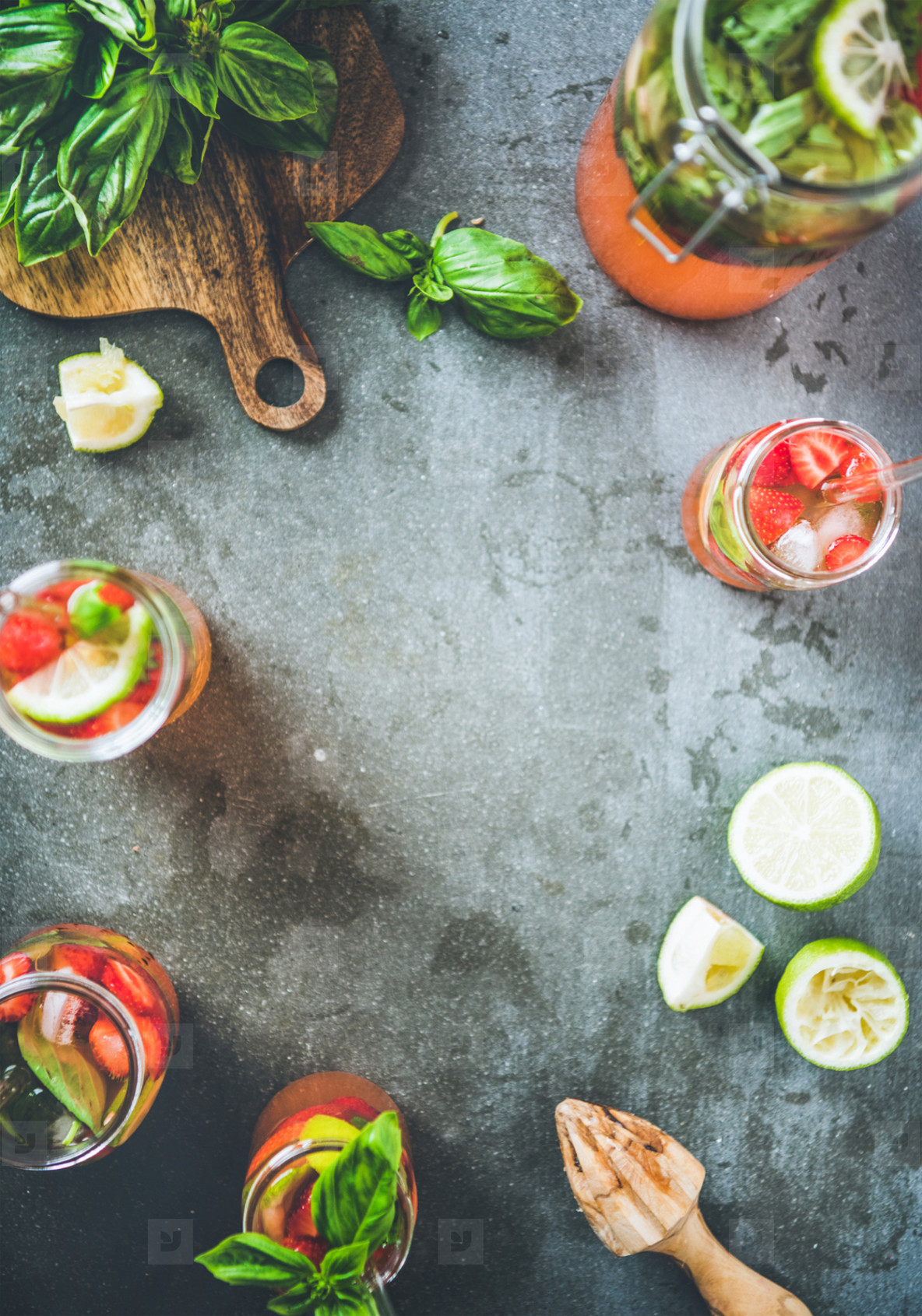 Fresh lemonade or iced tea with strawberry and basil  copy space