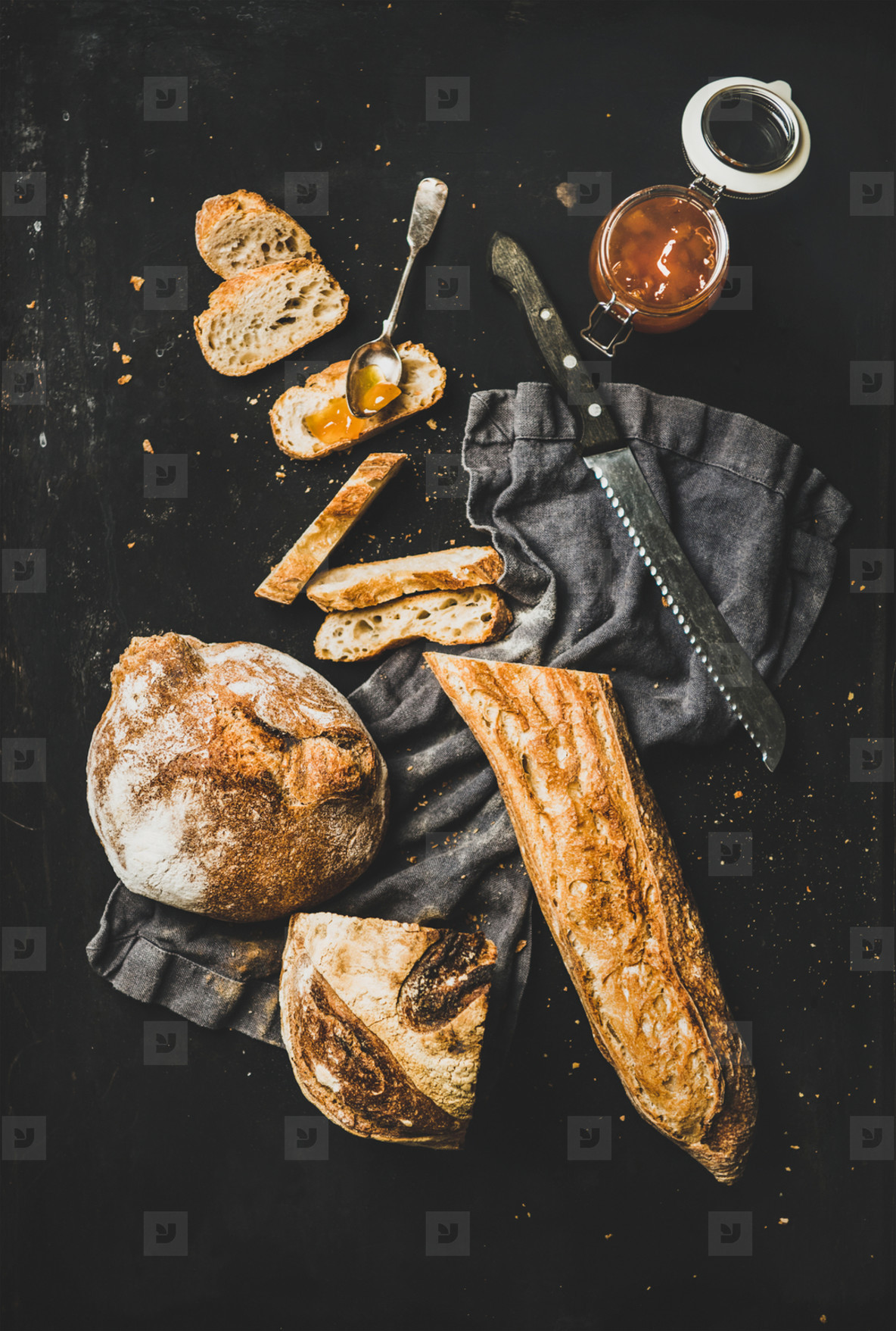 Flat lay of baguette  bread loaf and apricot jam
