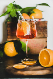 Aperol Spritz cocktail in glass with eco friendly straw  close up