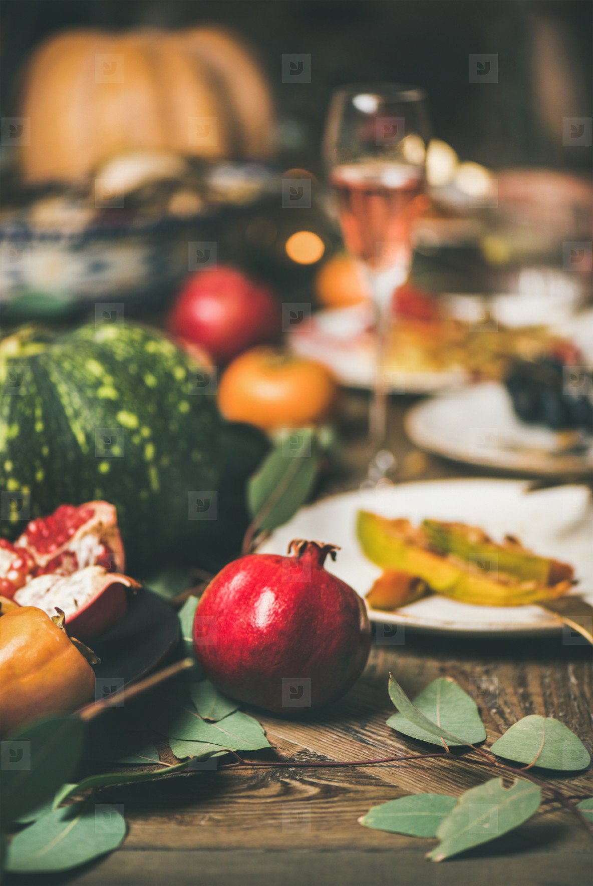 Rose wine and different snacks at festive Christmas table