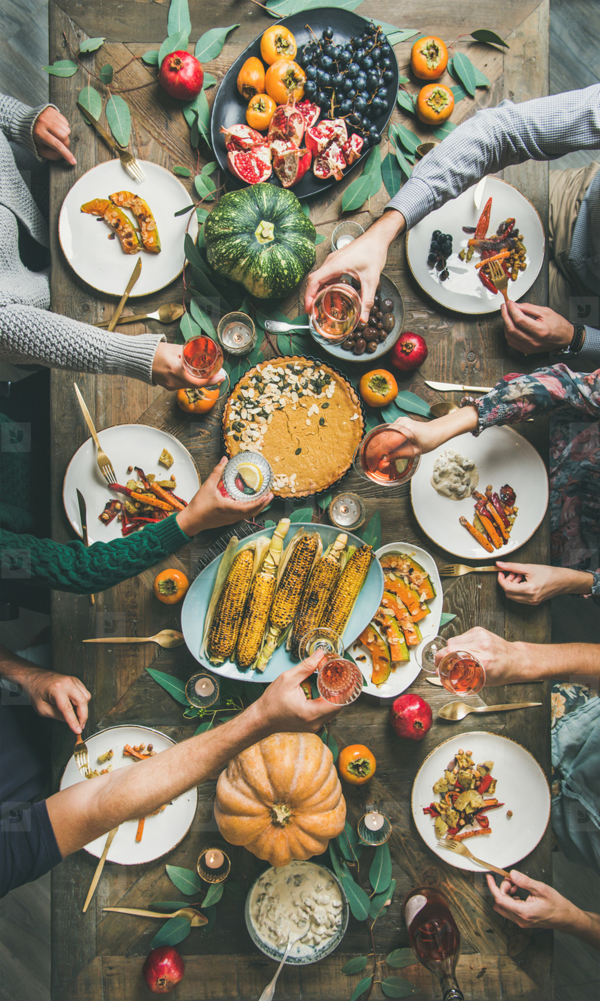 Flat lay of Friends clinking glasses at Thanksgiving Day  vertical composition