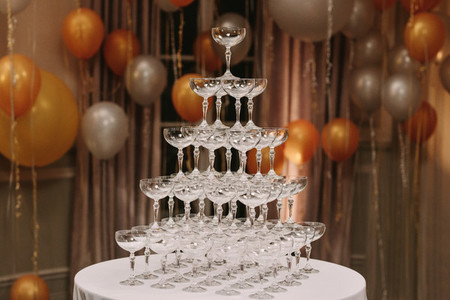 Pyramid of glasses at a new year party