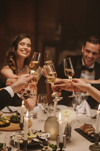 Socialites celebrating new years party with drinks