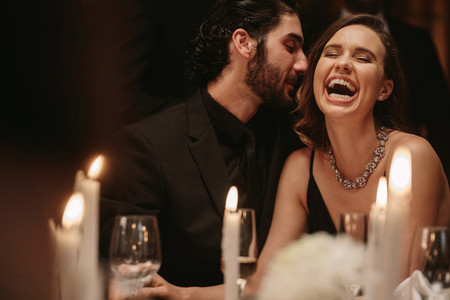 Loving couple having a fun at a gala dinner event